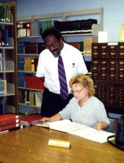Robert Taylor assisting a patron in the Tennessee Room in 1999.