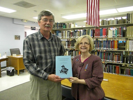 D.A.R member, Debbie Bosten presents the book to Jack Wood, Tennessee Room Librarian
