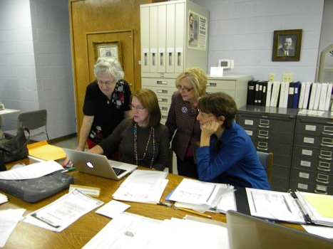 L-R: Beverly Dutcher, Kathy Williams, Debbie Boston, and Debbie Torstrick working hard on D.A.R papers in the Tennessee Room.