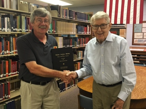 On August 2, 2016,Tennessee Room Librarian, Jack Wood (left) shakes hands with Bernard Malloy, who recently donated a copy of a family history book he co-authored with Frances Dean.